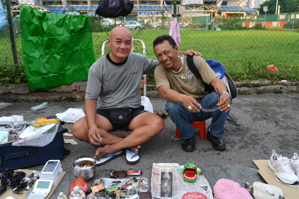 Mr. Ho on the left with a visitor to his stall